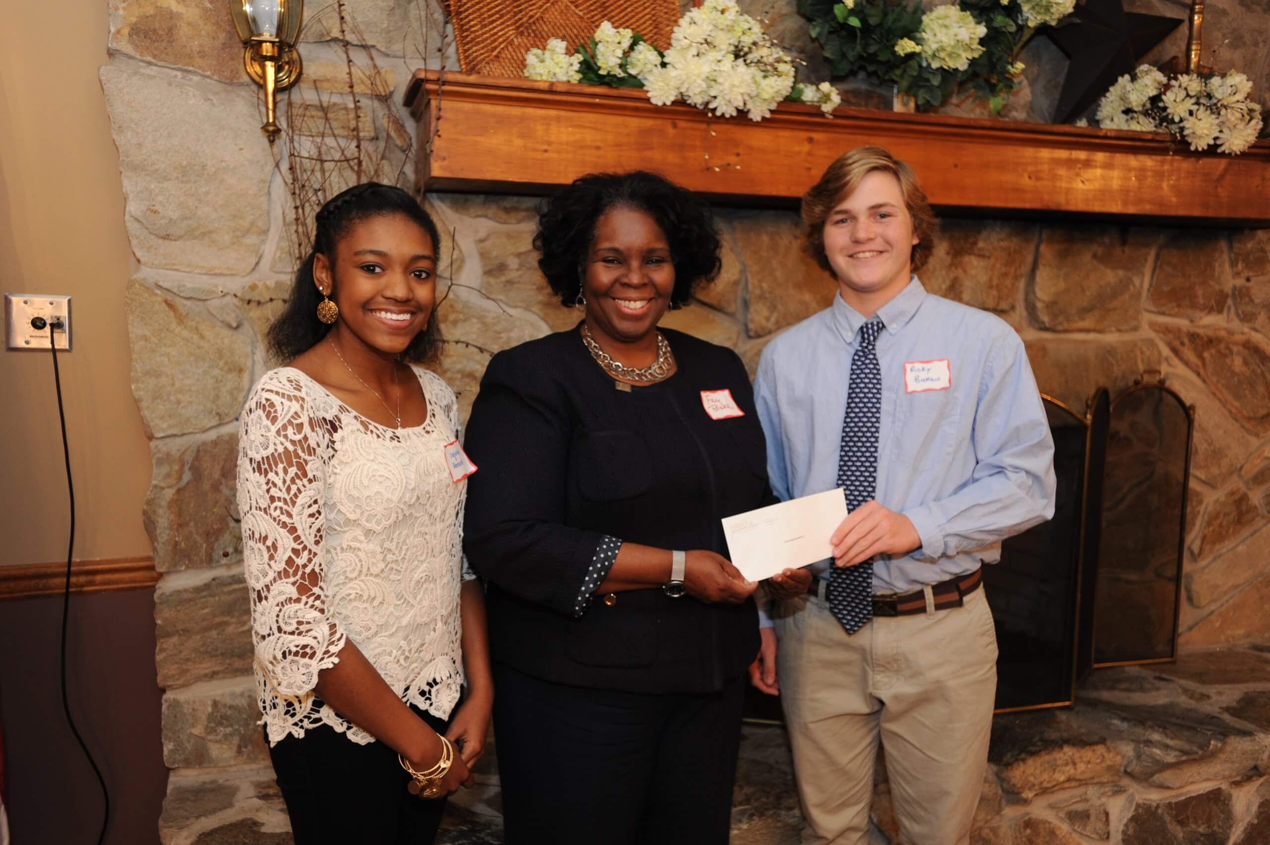 Sussex County YPB members Sequoia Bernard (left), a senior at Delmar High School and Rick Brokaw (right), a junior at Cape Henlopen High School, present a $1,500  grant to Fay Blake, Sussex County director for Pathways to Success.