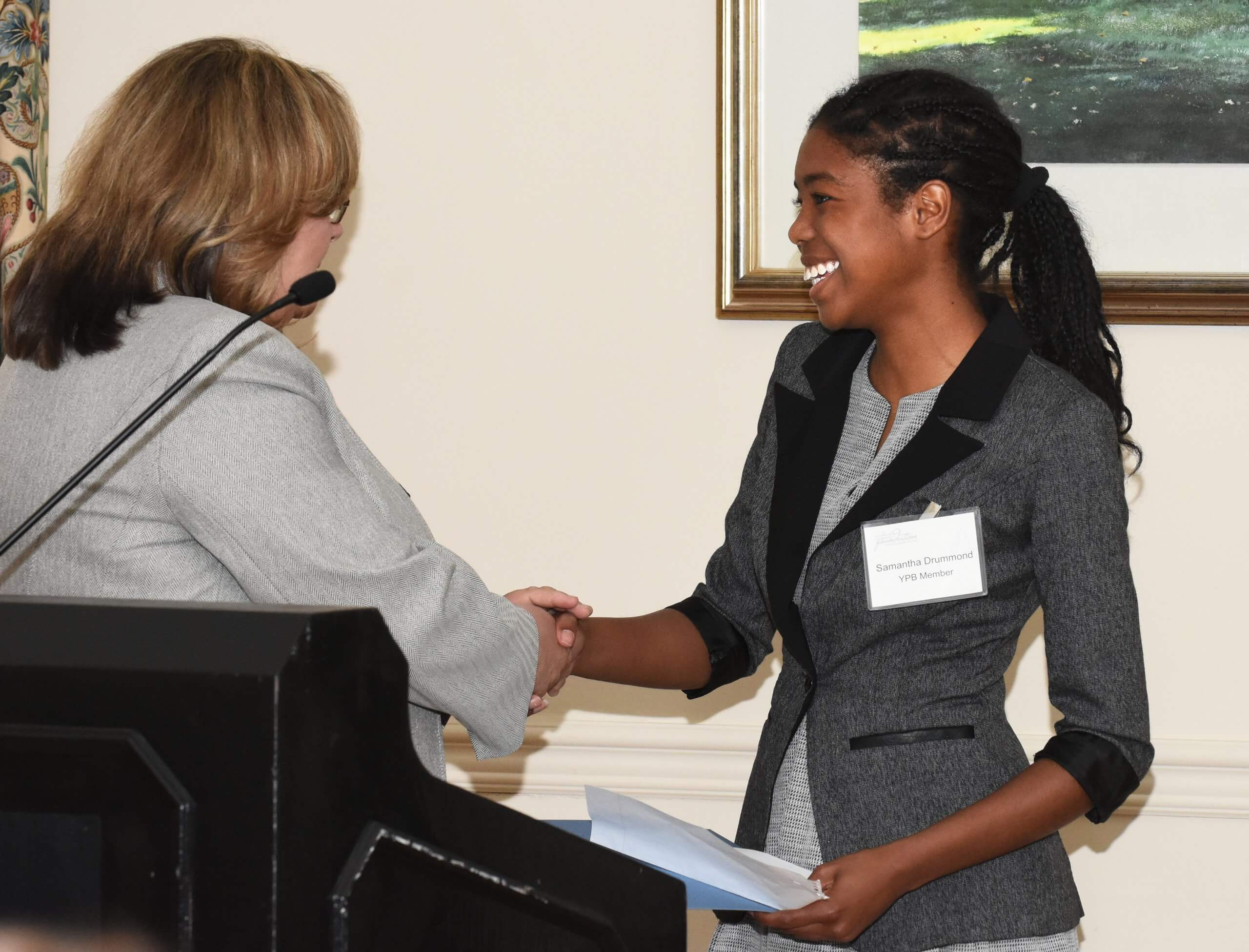 YPB member Samantha Drummond, a junior at Wilmington Christian School, presents a grant to the YWCA's Cindy LaRock.