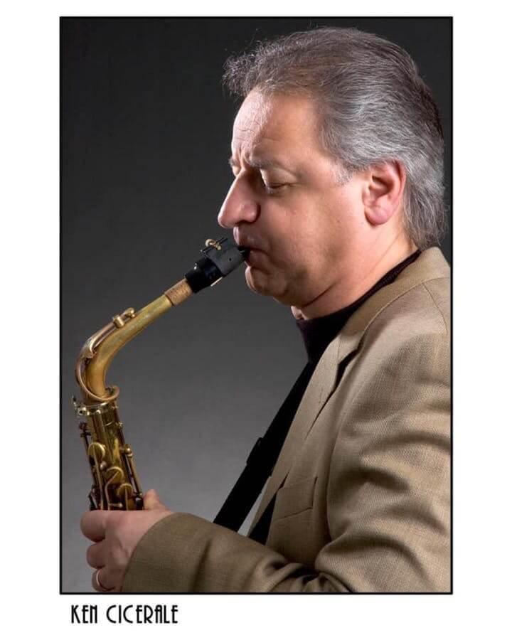 Ken Cicerale playing a saxophone